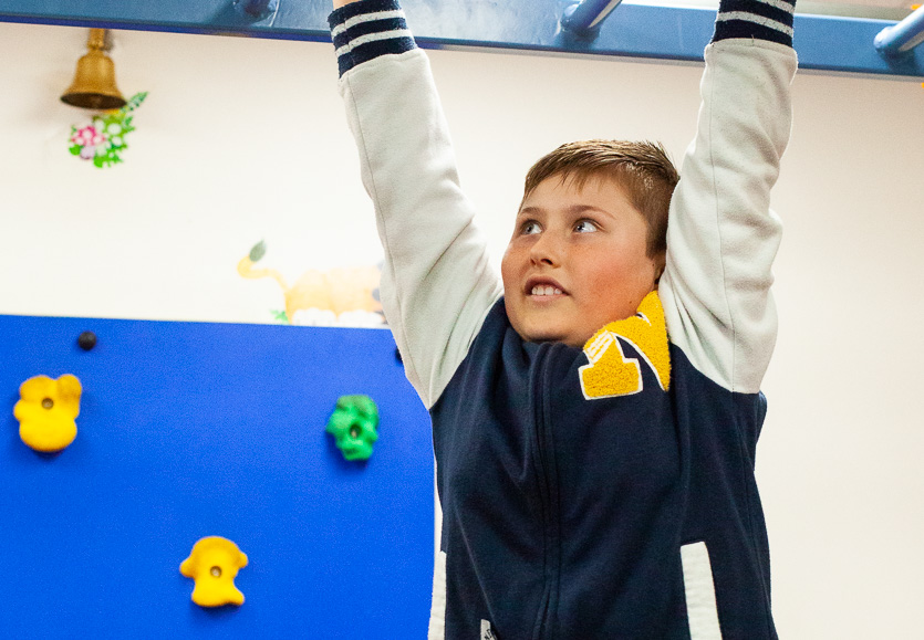 Physiotherapy - child on monkey bars